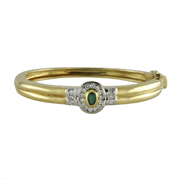 18K Yellow Gold Ladies' Diamond And Emerald Bangle.  0.70Ct Emerald; 0.75Ctw.